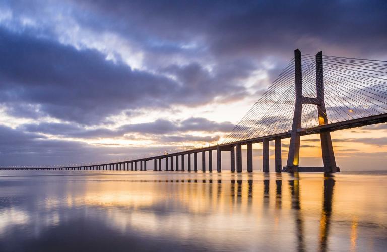 Long bridge reaching into the horizon.
