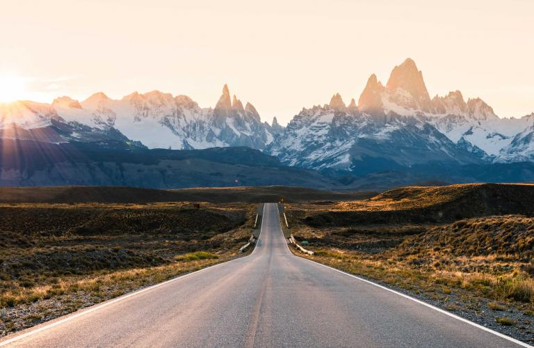 Long road leading to a mountain.