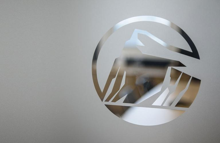 Image of Rock logo etched in glass.
