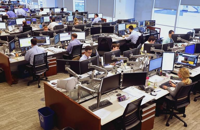 This picture shows people working at their desks