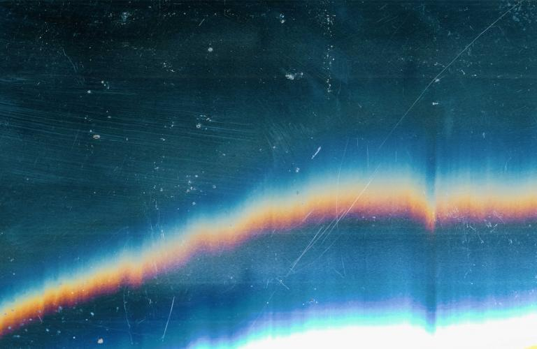 Dark rainbow textured background