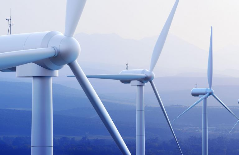 Turbines with distant mountains