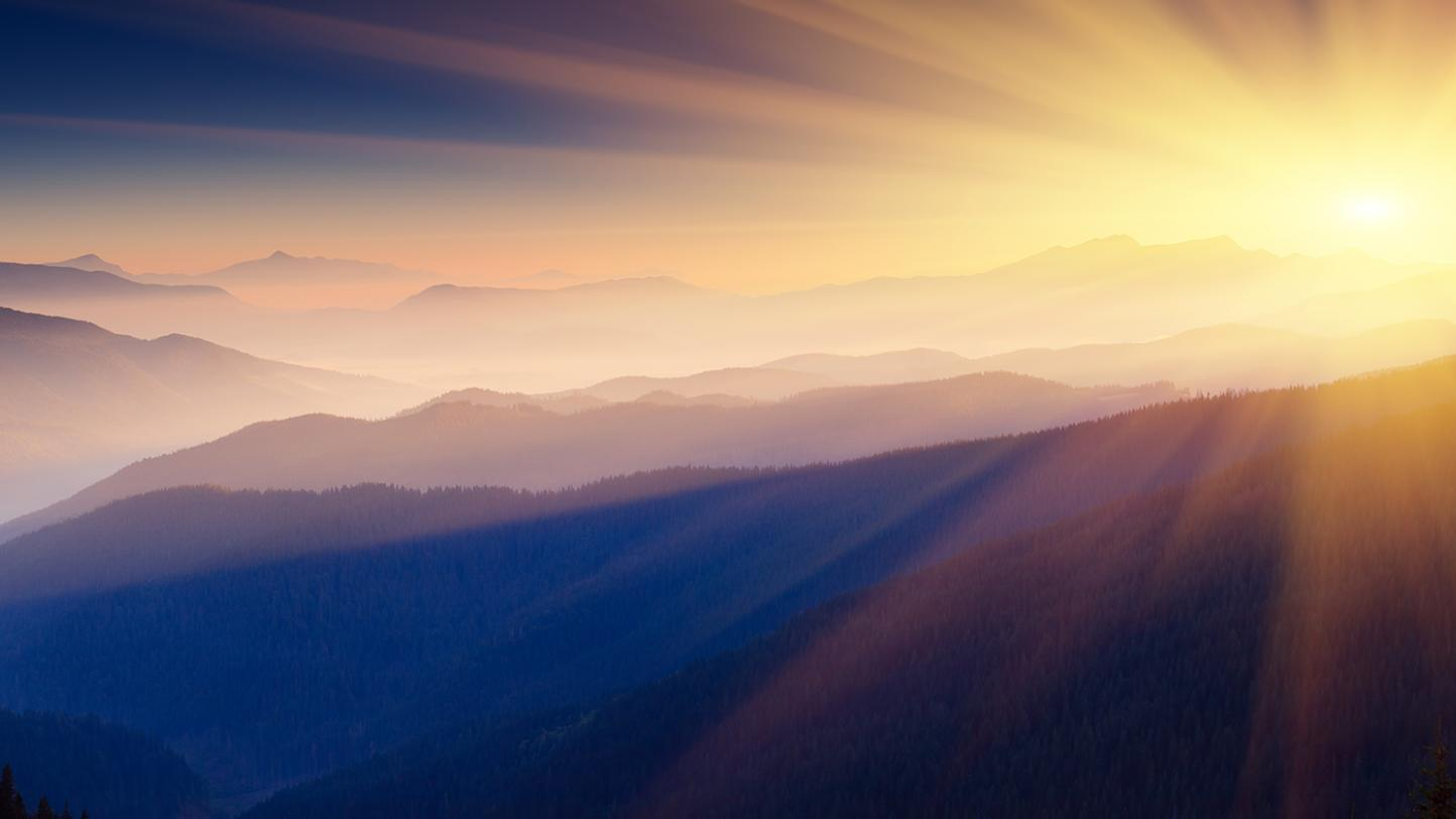 Photo of sun over the mountains
