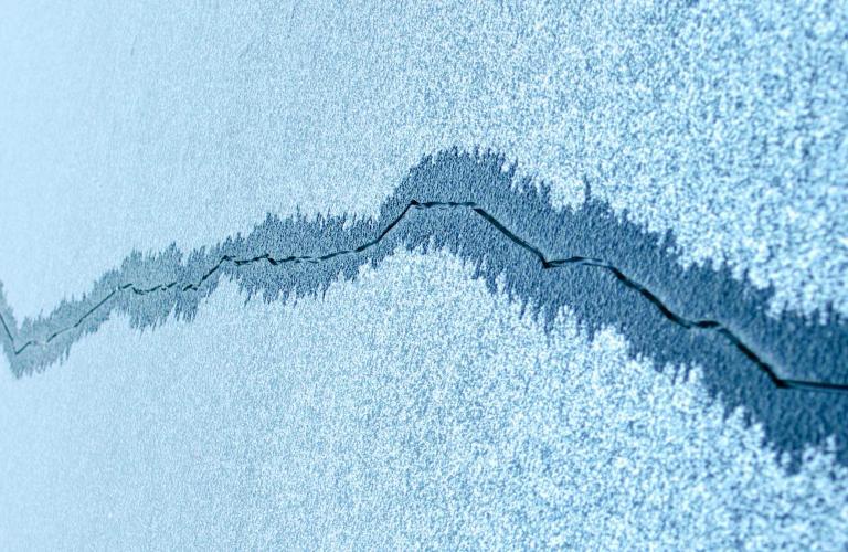 Crack in ice depicting risk