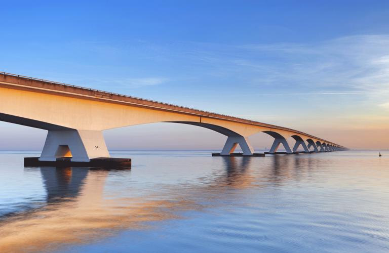 Bridge over water into the Horizon